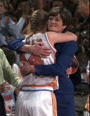 Tennessee coach Pat Summitt hugs Kellie Jolly in the final minute of the championship game of the Women's Final Four at Kemper Arena in Kansas City, Mo., Sunday, March 29, 1998. Tennessee won 93-75 over Louisiana Tech to have a perfect 39-0 season.