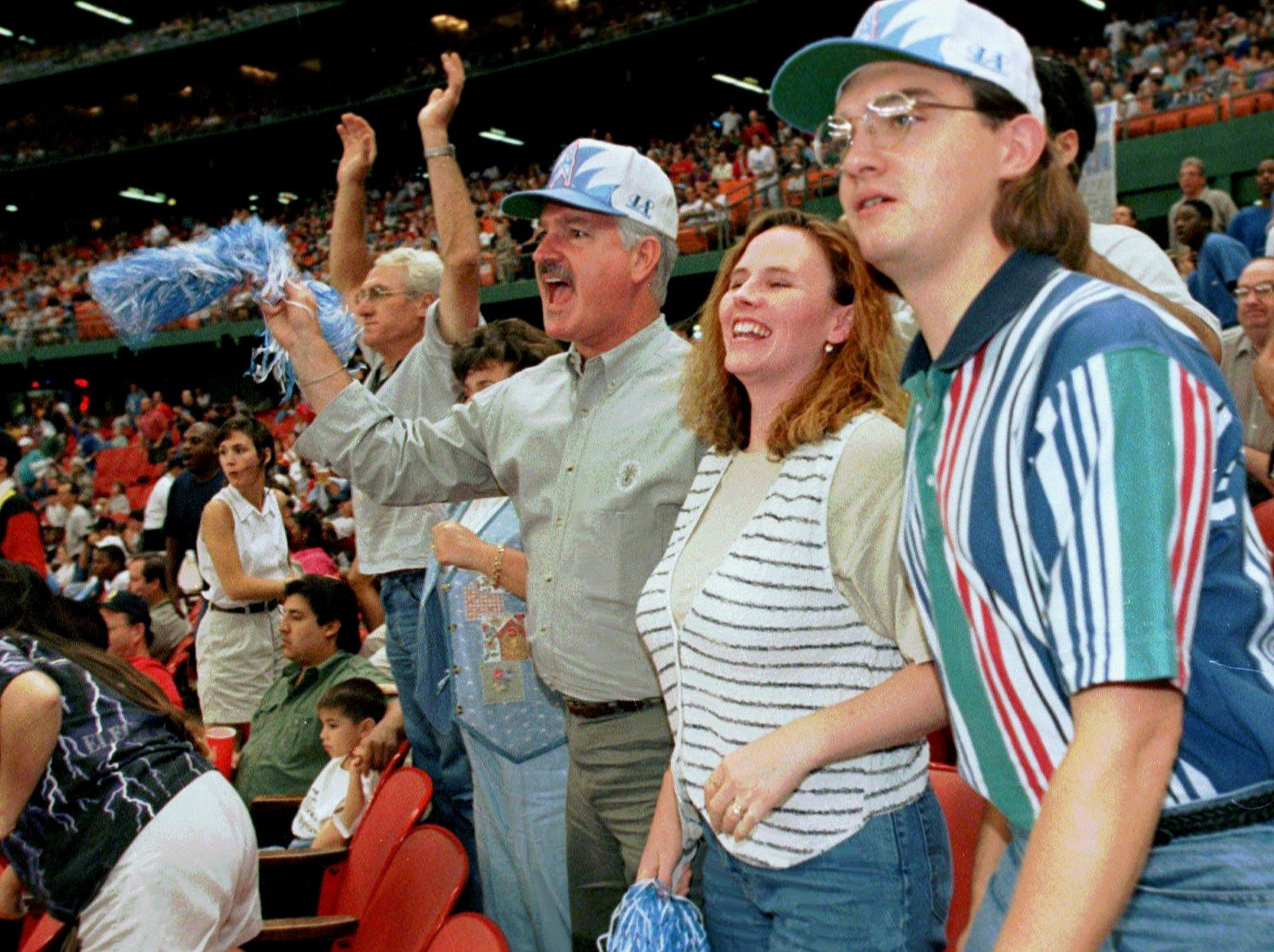 Nashville residents came to the Astrodome in Houston Sept. 1, 1996 to cheer for the Oilers against the Kansas City Chiefs.. They are Laura Allen, left, Ken Allen, Denise and Scott Jungmichel.