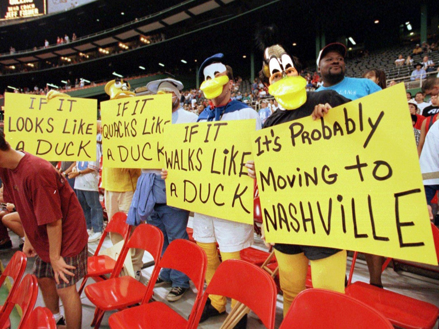 Wearing duck beaks, Paul Mewis, left, David Wyborny, Geoff Hutson and Paul Tepikian make comments on the Houston Oilers' planned move to Nashville next season during the Sept. 1, 1996 game against the Kansas City Chiefs in Houston.