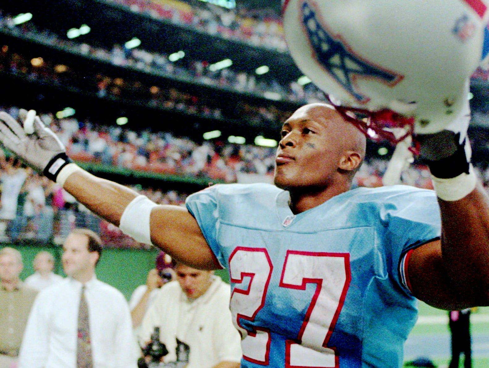Houston Oilers Eddie George (27) celebrates with fans after the Oilers defeated the Pittsburgh Steelers 23-13 Oct. 20, 1996 in Houston. The rookie running back gained 65 yards and scored the final touchdown of the game.