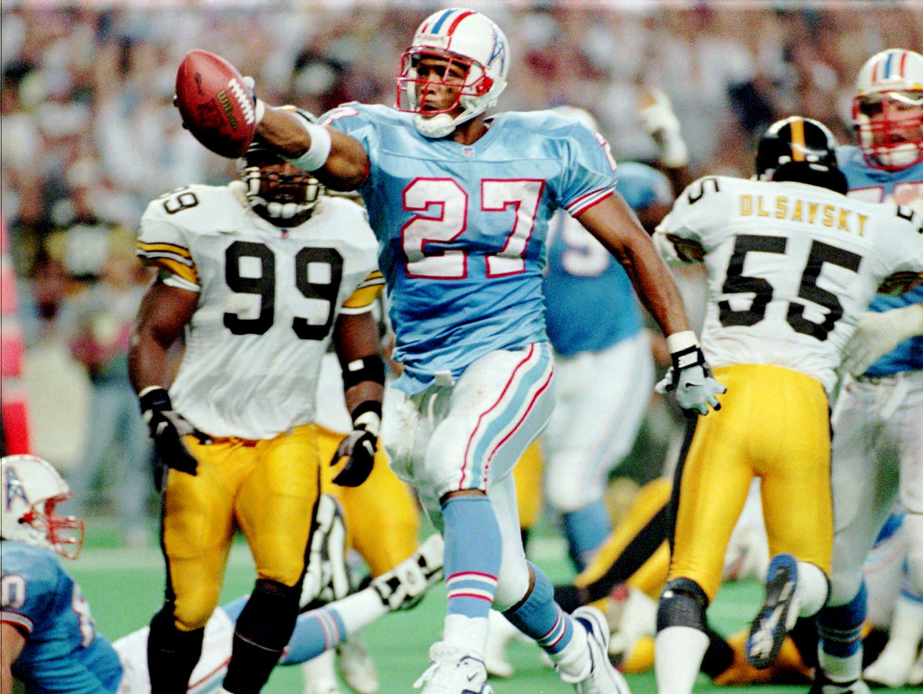 Houston Oilers running back Eddie George (27) skips into the end zone late in the fourth quarter for a touchdown against the Pittsburgh Steelers Oct. 20, 1996 in Houston.
