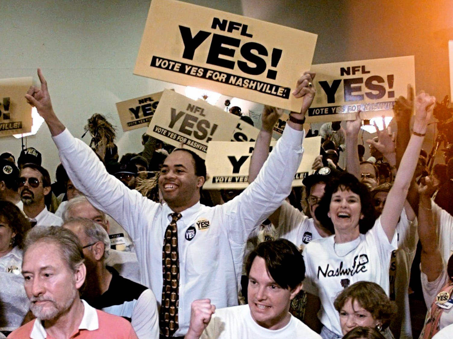 Supporters of a referendum bringing the Houston Oilers to Nashville celebrate its passage May 7, 1996 in Nashville. By a margin of 59 percent to 40 percent, voters brought the NFL team to Tennessee, making it the first big league franchise in the state.