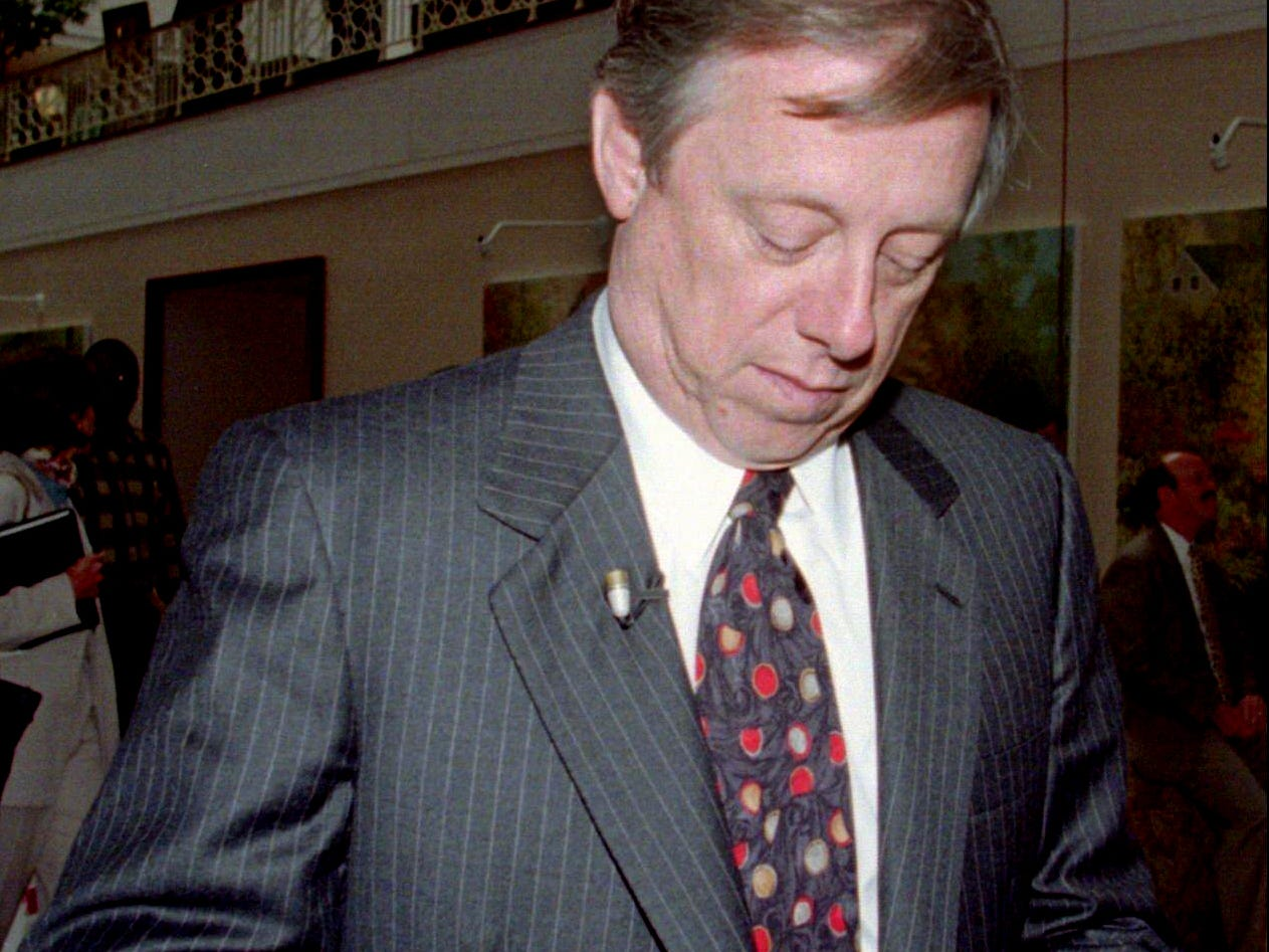 Metro Mayor Phil Bredesen buttons his coat as he gets ready for an interview in the Atlanta hotel after NFL owners voted to approved the relocation of the Houston Oilers to Nashville April 30, 1996 after a four and a half hour meeting.
