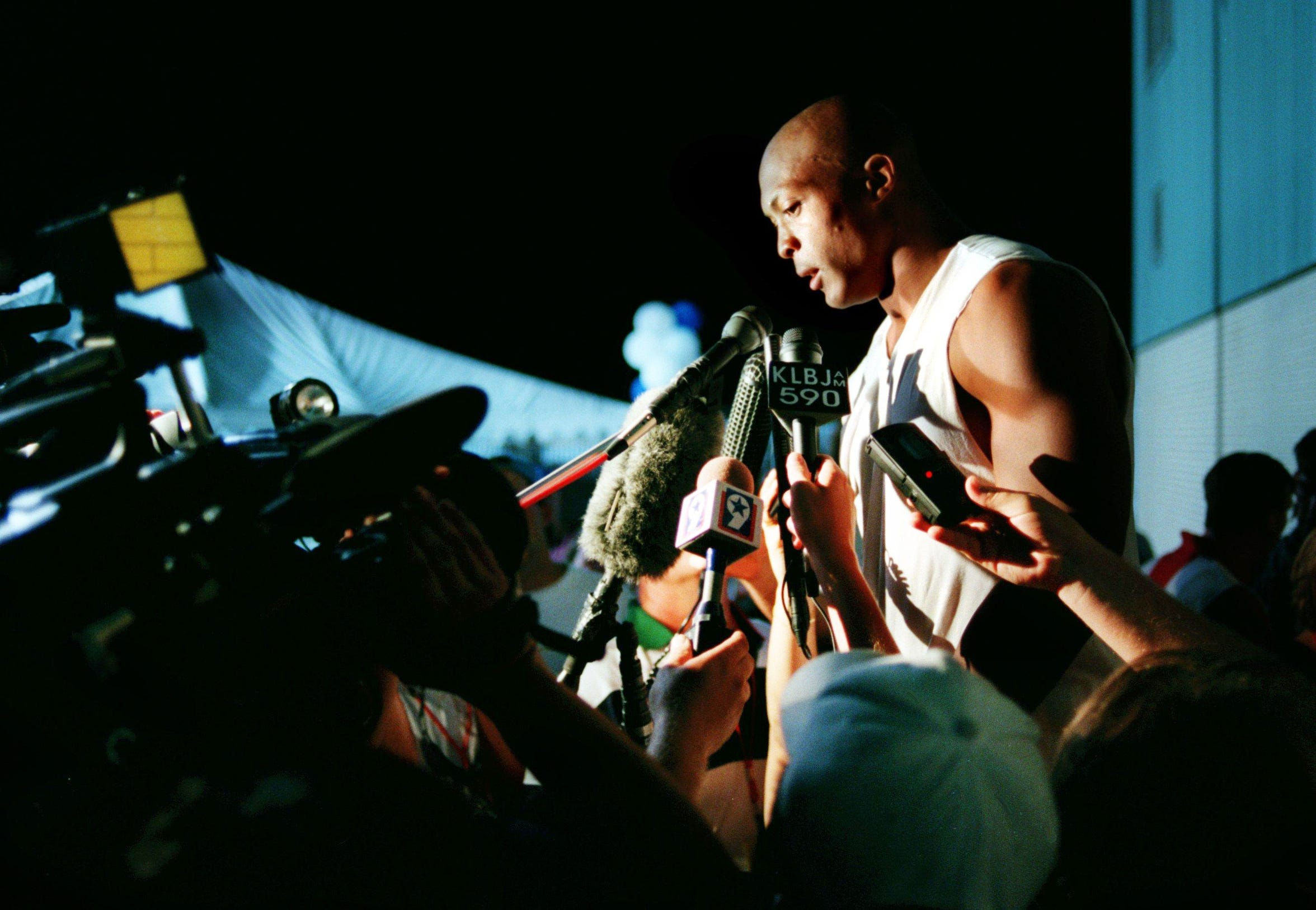 Houston Oilers rookie running back Eddie George talks with the media after a scrimmage with Dallas Cowboys in Austin, Texas during training camp July 24, 1996.