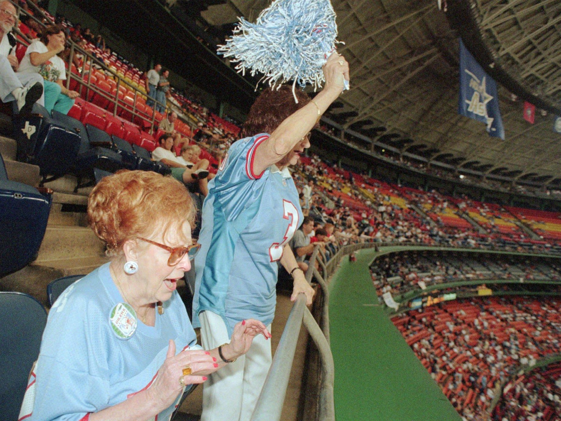 Houston Oilers fans since 1960, Frances Proctor, left, and Renee May cheer for their team in the final quarter of the Oilers' 20-19 loss to the Kansas City Chiefs Sept. 1, 1996, in Houston. As the Oilers play possibly their final season in Houston before moving to Nashville, the fans are staying away in droves.