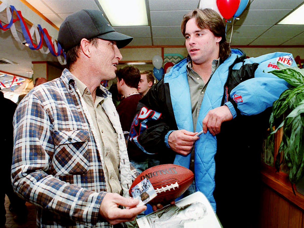 Harlen Heimbach, left, talks with Houston Oilers center Mark Stepnowski at a McDonald's restaurant in Jackson, Tenn. Jan. 10, 1996. Several Oilers players and cheerleaders were on a bus tour of West Tennessee cities to promote sale of personal seat licenses for a proposed new stadium to be built in Nashville.
