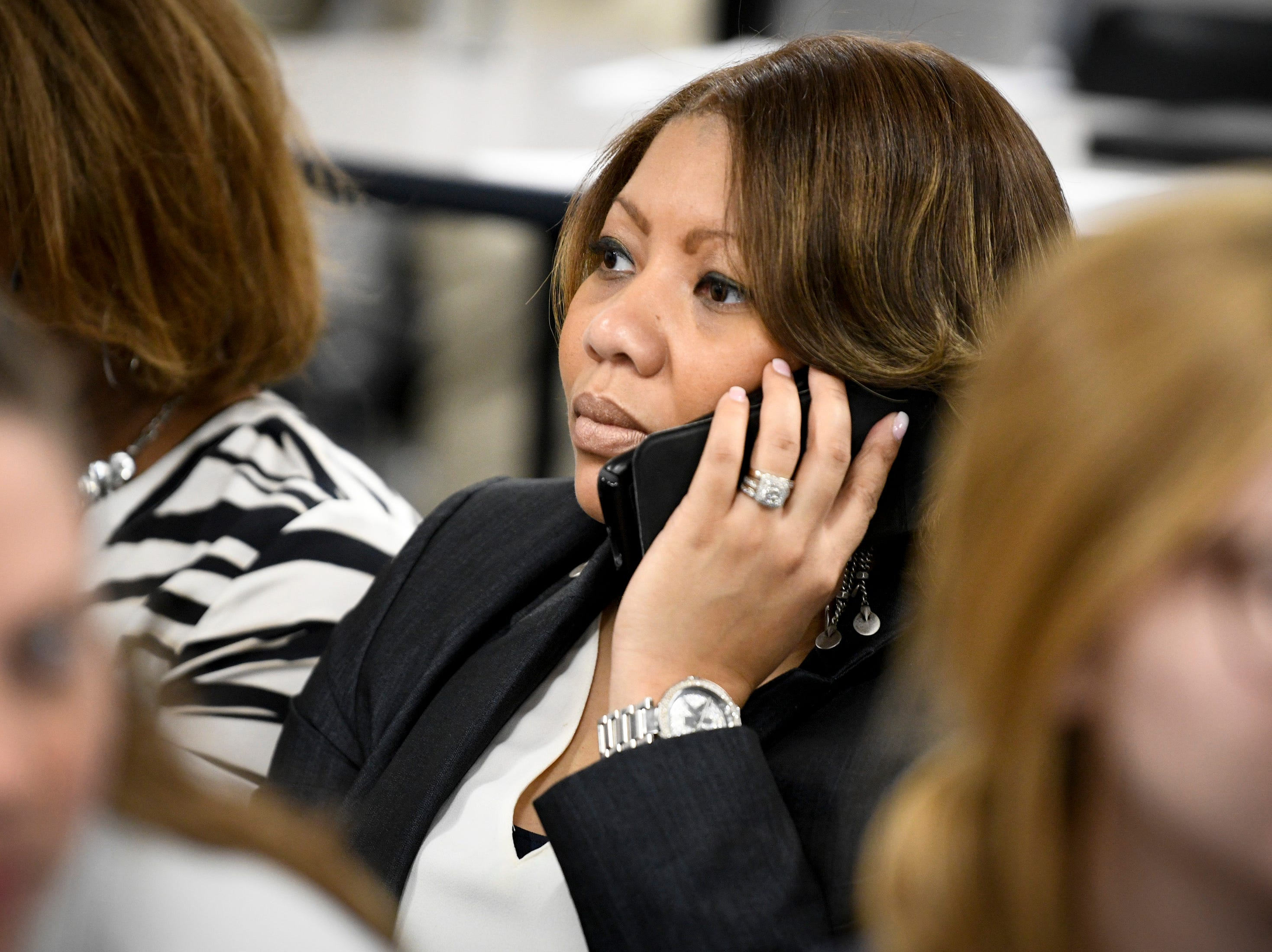 MNPS Community Superintendent Dr. Adrienne Battle makes a phone call before the MNPS Board of Public Education meeting at the Administration Building of Metropolitan Public Schools in Nashville, Tenn., Tuesday, April 9, 2019.