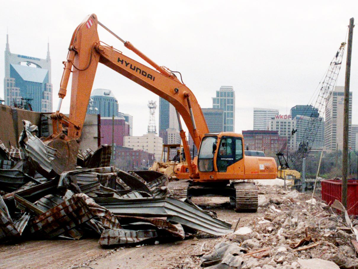 A member of the Mashburn Excavation and Demolition Company works to separate scrap metal from garbage to be recycled at the site of the new football stadium March 18, 1997.