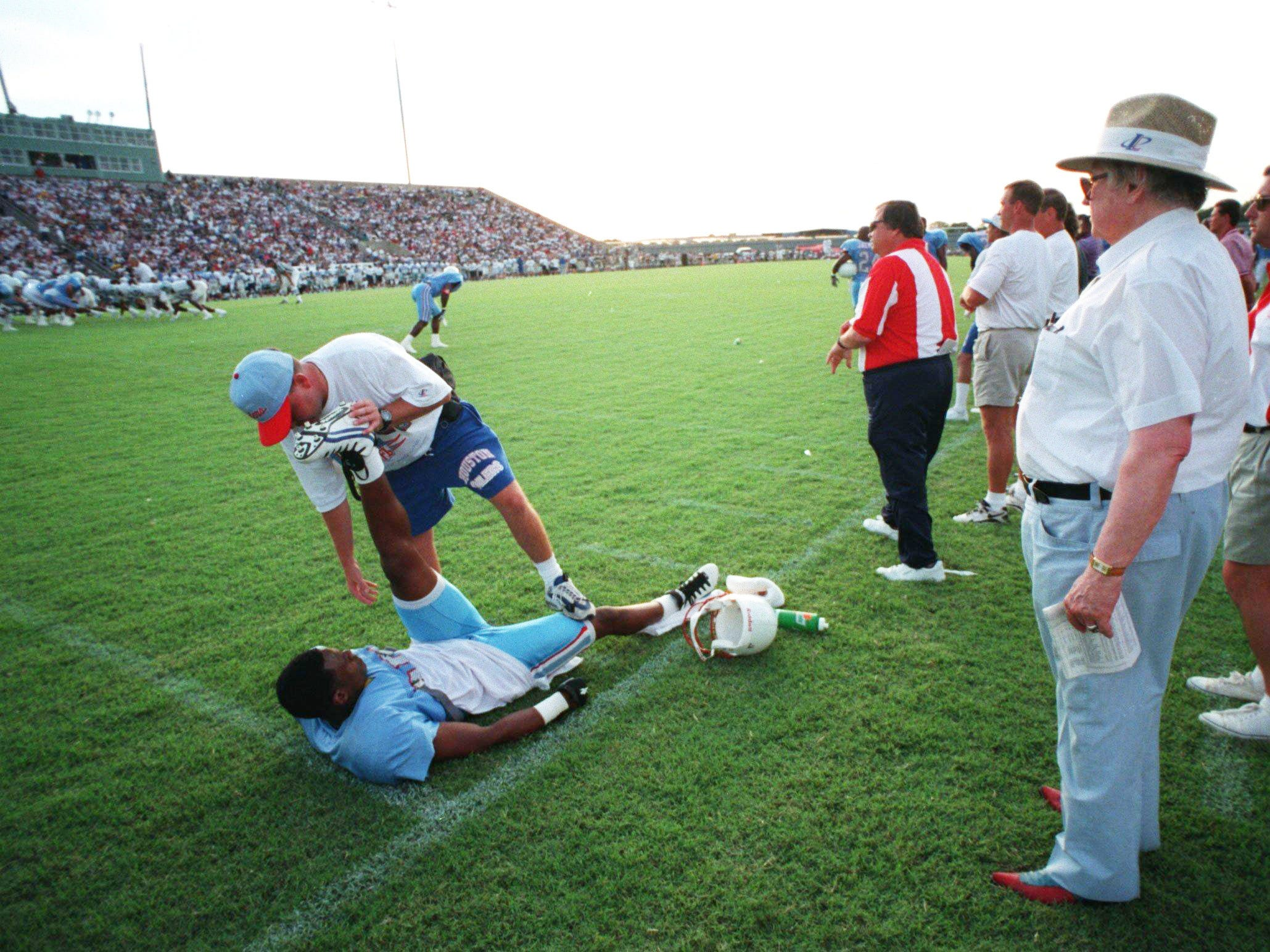 Houston Oilers owner Bud Adams, right, watching the scrimmage against the Dallas Cowboys in Austin, Texas July 24, 1996.
