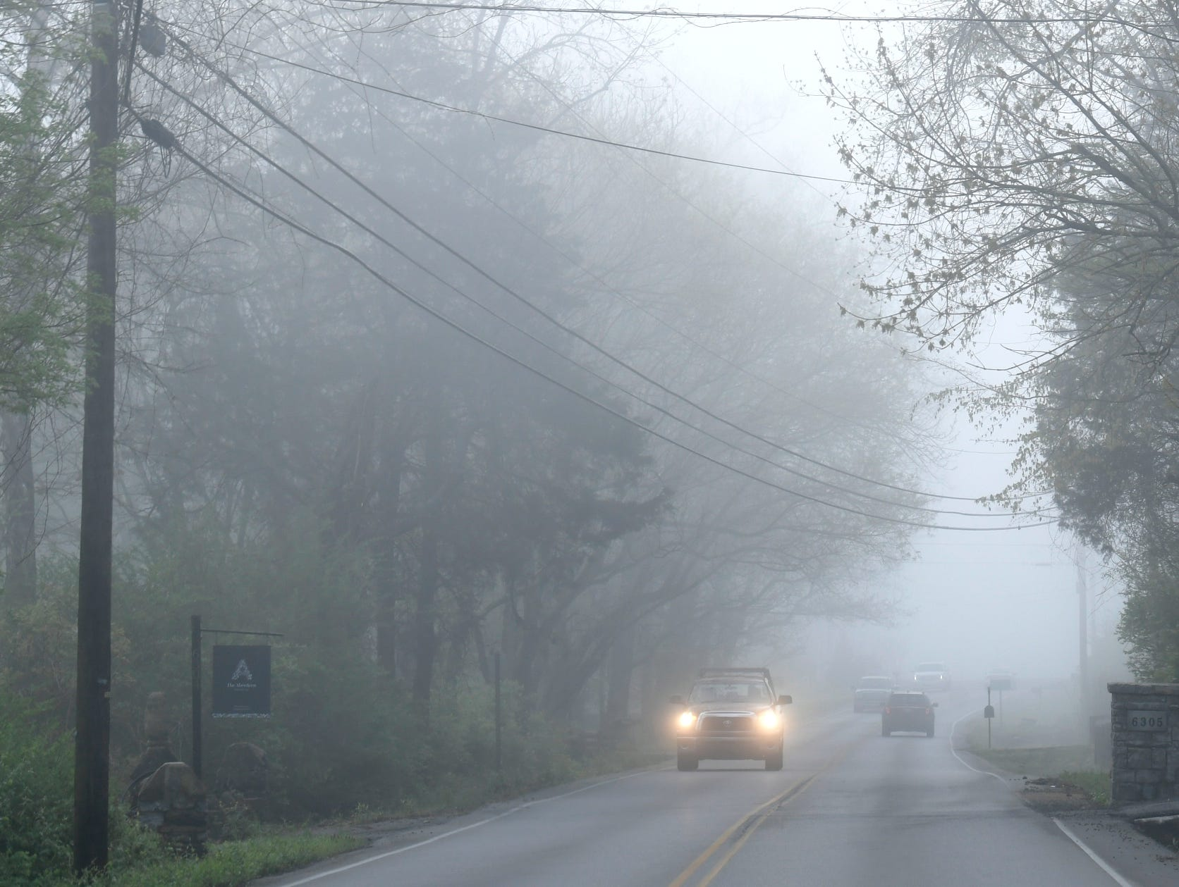Cars travel down a foggy Murray Lane in Brentwood on Tuesday morning,  April 8, 2019. A dense fog advisory was issued for Middle Tennessee.