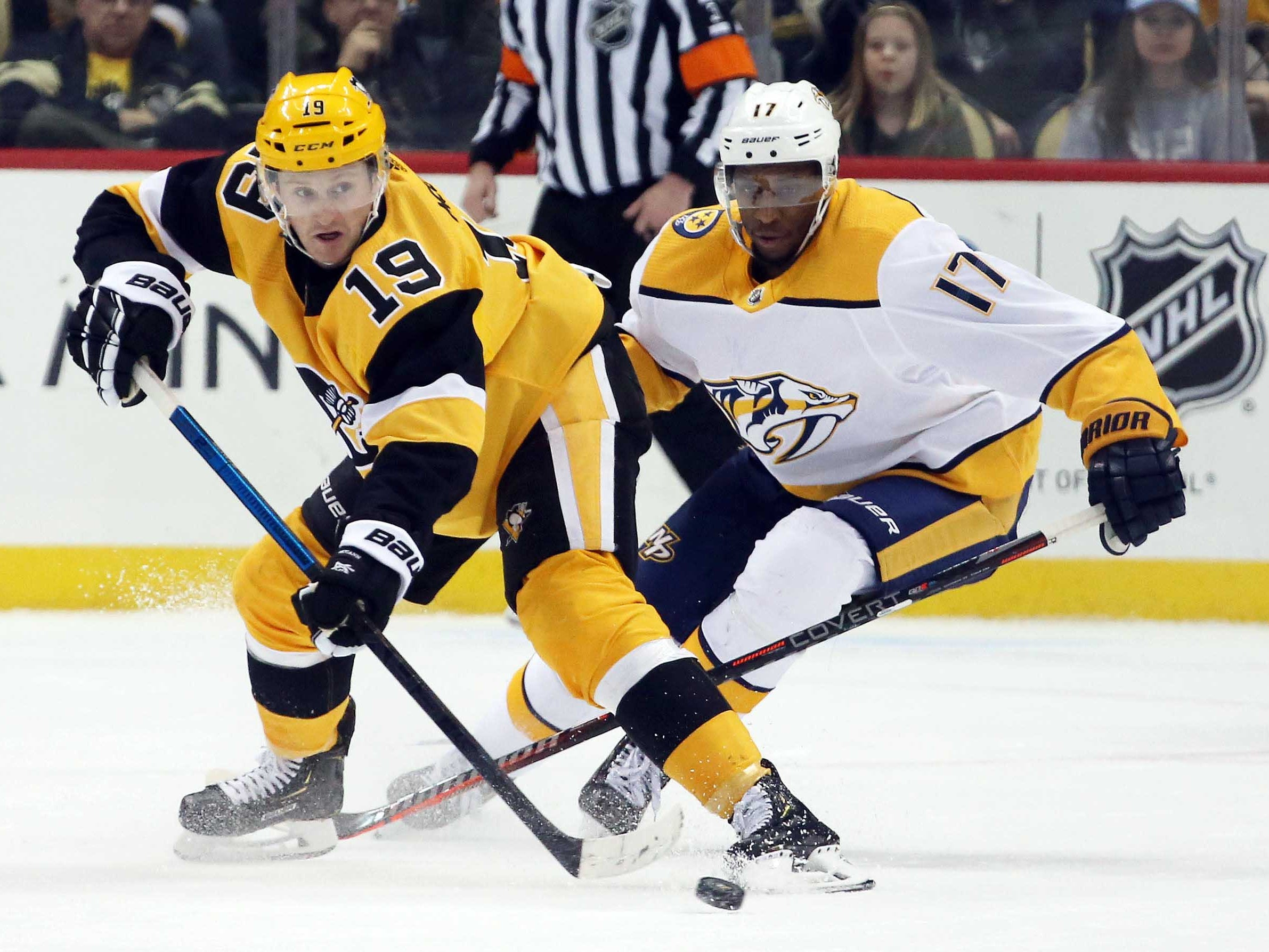 Mar 29, 2019: Predators 3, Penguins 1 -- Pittsburgh Penguins center Jared McCann (19) moves the puck against Nashville Predators right wing Wayne Simmonds (17) during the third period at PPG PAINTS Arena. Nashville won 3-1.