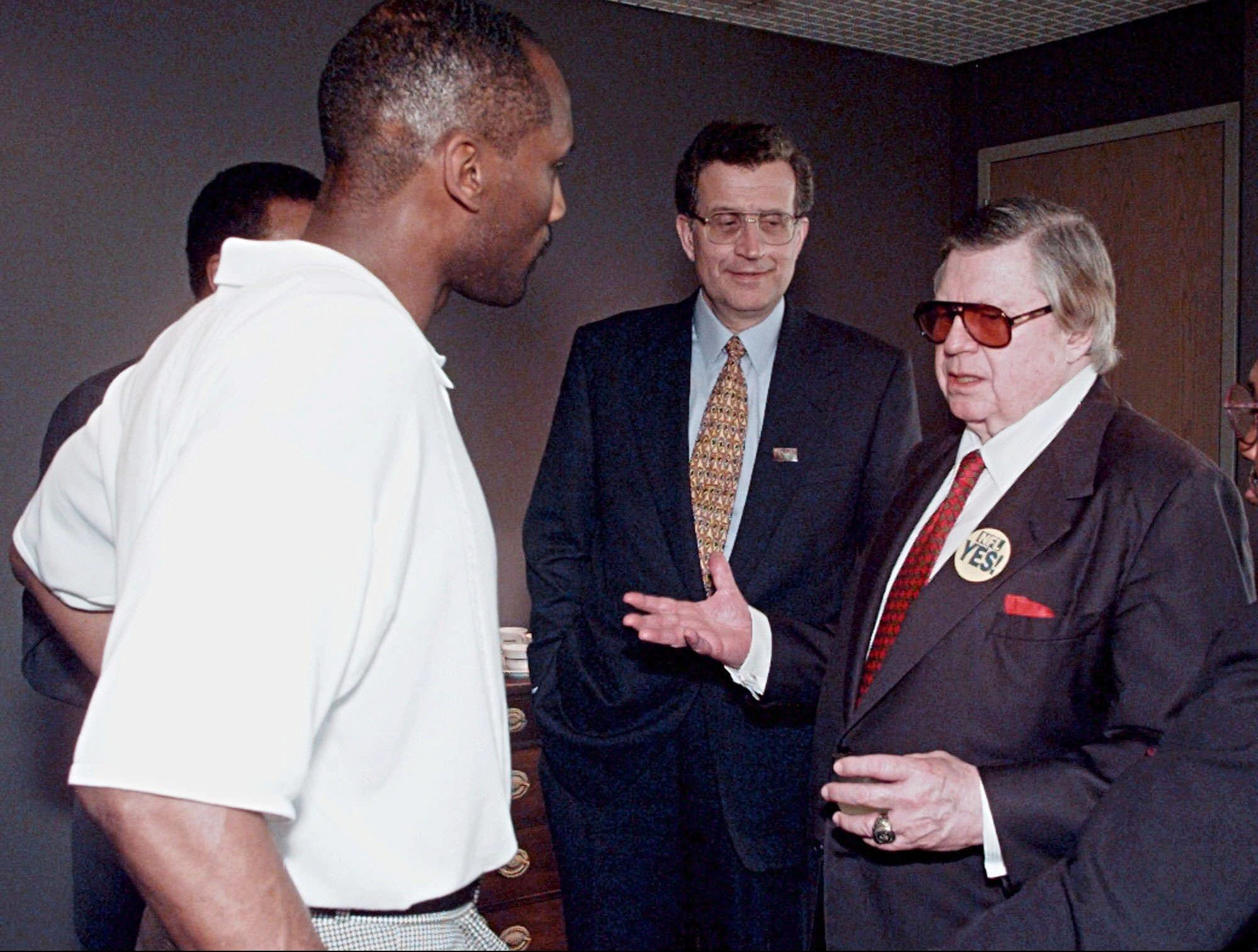 Houston Oilers owner Bud Adams, right, talks with Tennessee State University football coach L. C. Cole, left, during a visit to the Nashville May 6, 1996. NFL Commissioner Paul Tagliabue, center, and Adams made several stops around Nashville the day before the public votes on spending public funds on the 65,000-seat stadium the Oilers will play in if they move to Nashville. Tennessee State will play its home games in the new stadium if the public votes in favor of the spending.