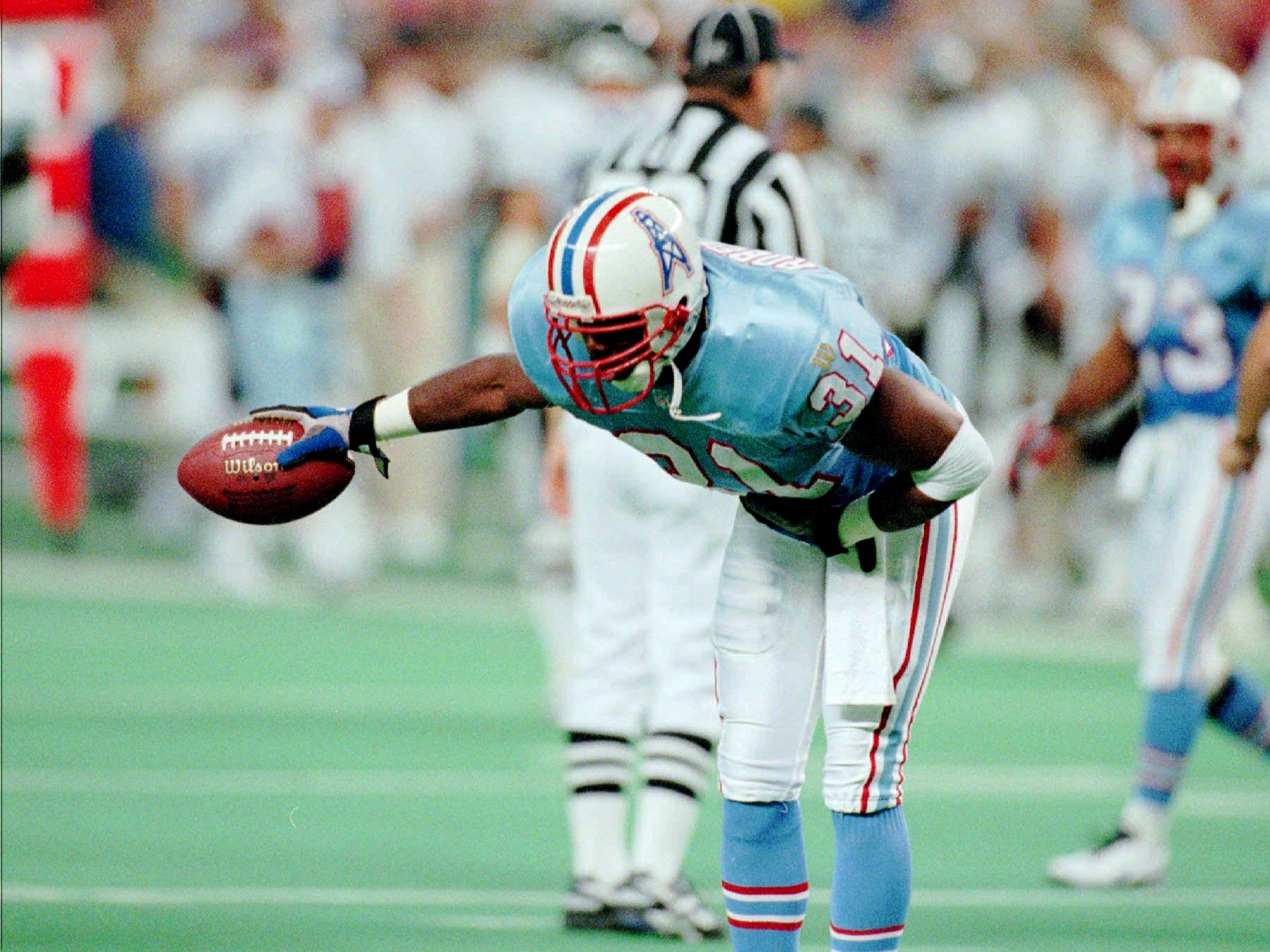 Houston Oilers safety Marcus Robertson (31) takes a bow after intercepting a pass intended for Baltimore Ravens receiver Calvin Williams during the first quarter Sept. 15, 1996 in Houston. The Oilers beat the Ravens 29-13.