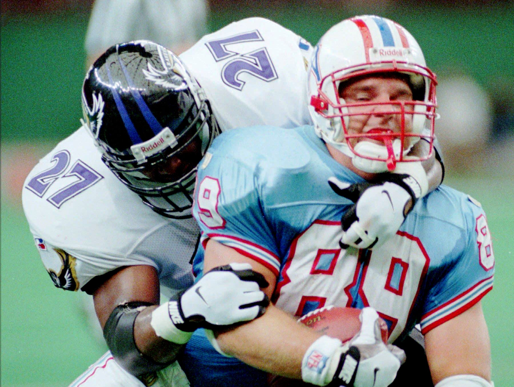 Houston Oilers tight end Frank Wycheck (89) is tackles by Baltimore Ravens defender Stevon Moore (27) after catching a pass for a gain of five yards during the second quarter Sept. 15, 1996 in Houston. Wycheck caught six passes for 64 yards and one touchdown in the Oilers 29-13 win over the Ravens.