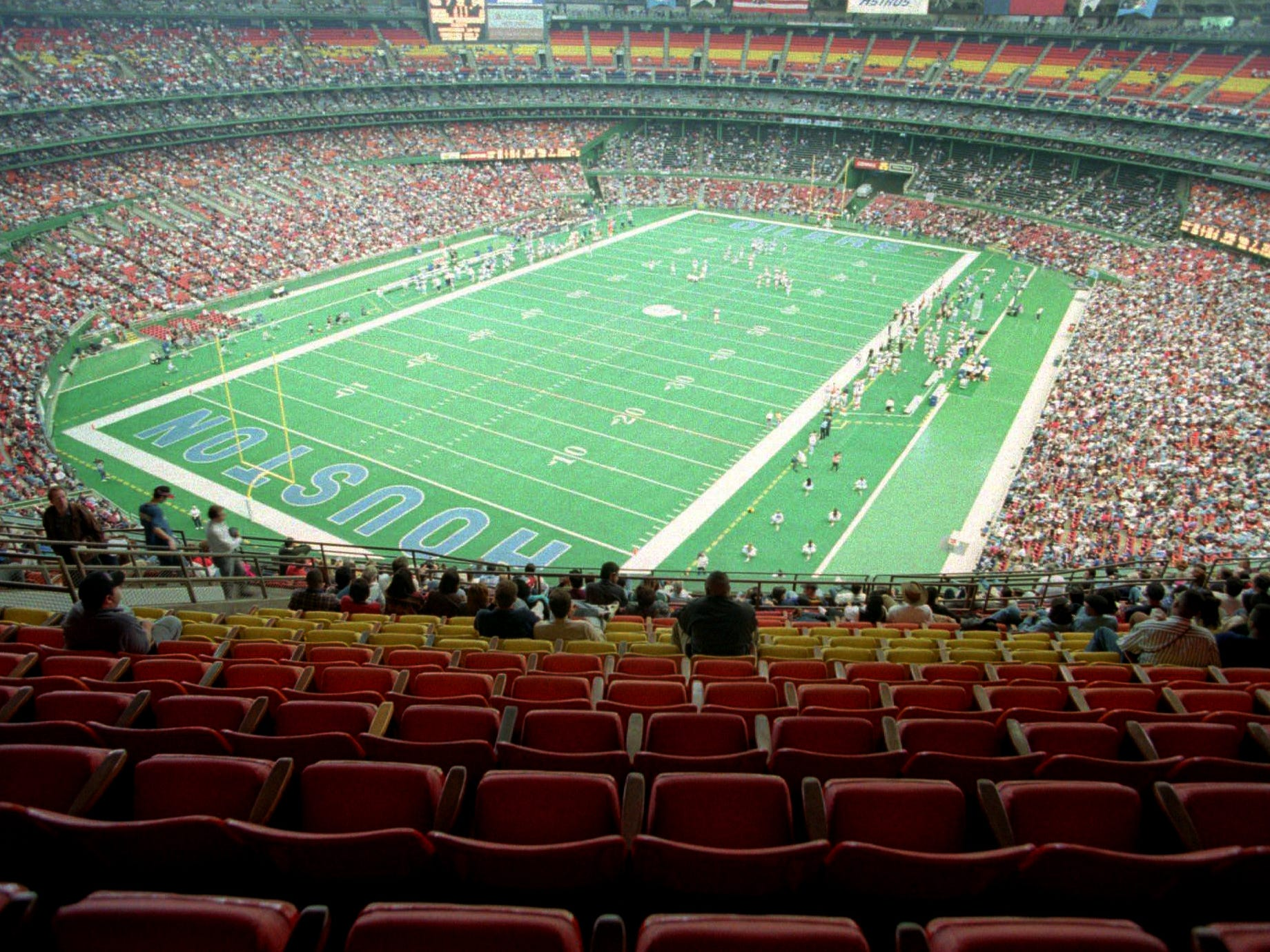 Nearly half the seats were empty in Houston's Astrodome as the Houston Oilers play the Cincinnati Bengals Nov. 12, 1995. Oilers owner Bud Adams has cited lack of fan interest as one of his reasons for moving the team to Nashville, Tenn.
