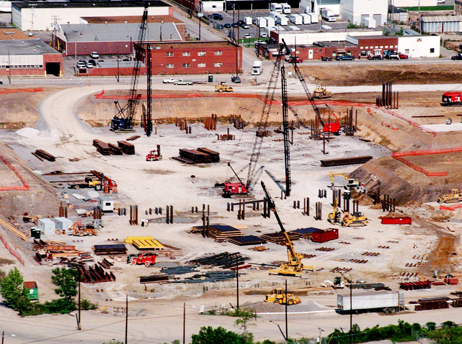 Construction moves along with the sinking of steel beams into the ground at the lowest point of the new football stadium Aug. 22, 1997. The field will obviously be lower than street level.