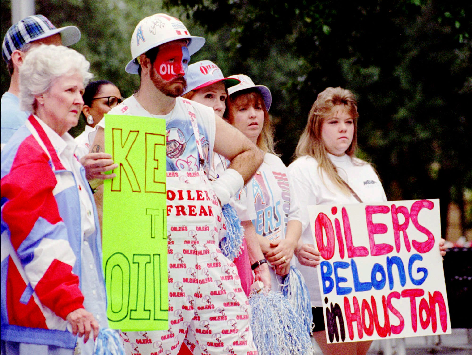 Some of the 65 supporters of the Houston Oilers stand in front of City Hall during a rally to show support for keeping the team in Houston Dec. 6, 1995. The Oilers are in negotiations to move the team to Nashville, Tenn.