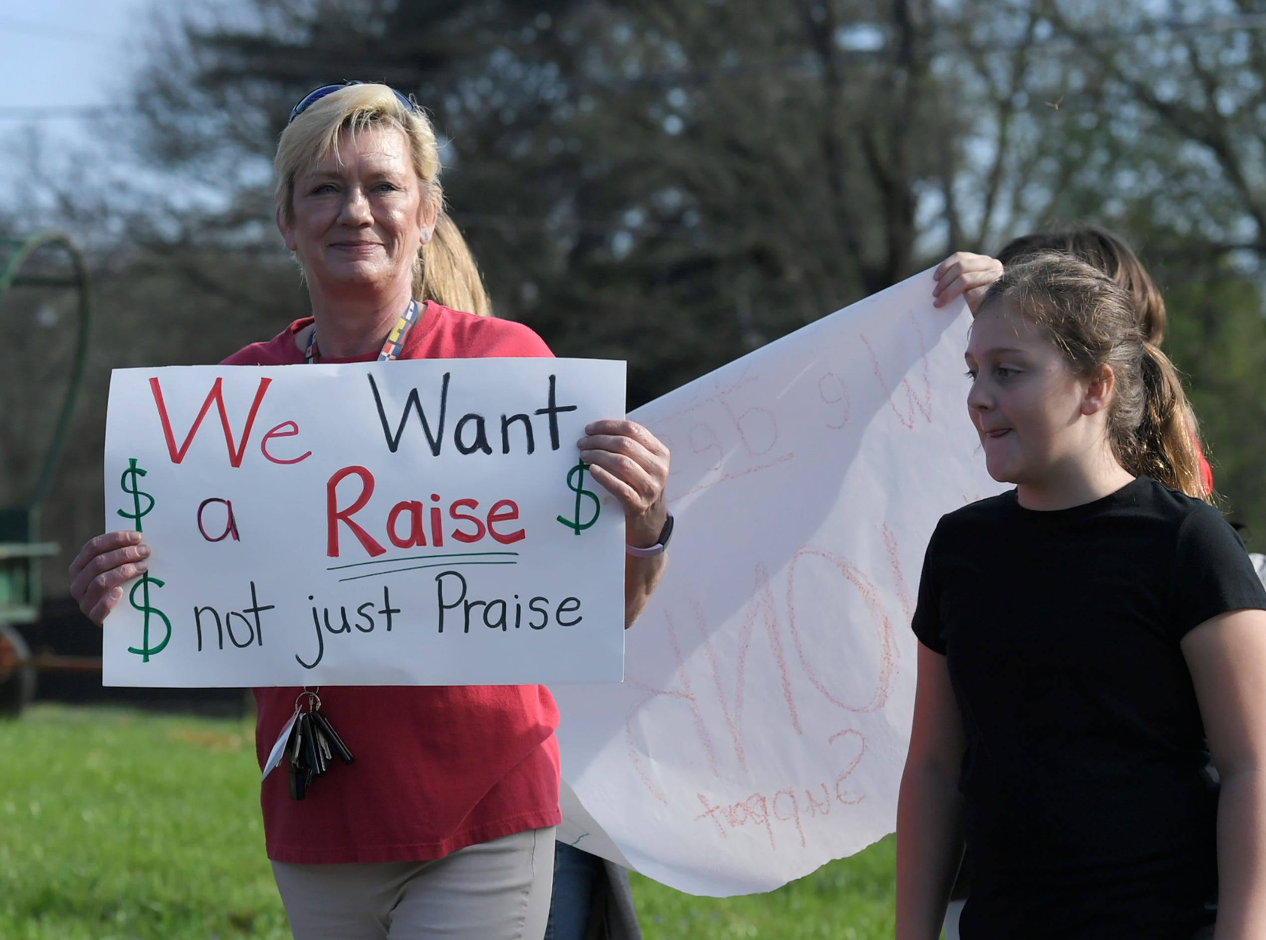 Supporters rally for teacher raises at JT Moore Middle School Tuesday, April 9, 2019, in Nashville, Tenn.