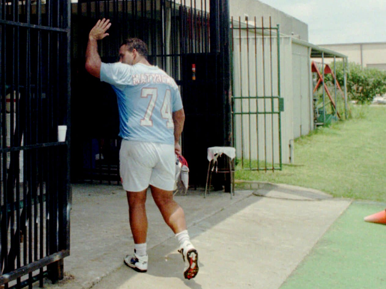 The Houston Oilers' Bruce Matthews, a 15-year veteran with the club, waves farewell after leaving the Oilers' Houston practice field for likely the last time June 12, 1997 in Houston. The Oilers finished their official minicamp session and scheduled to become the Tennessee Oilers for the next season.