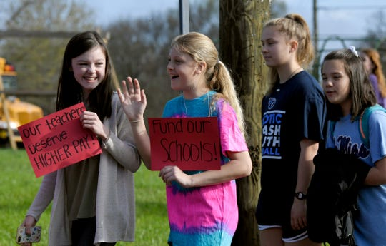 Supporters rally for teacher raises at JT Moore Middle School on April 9.