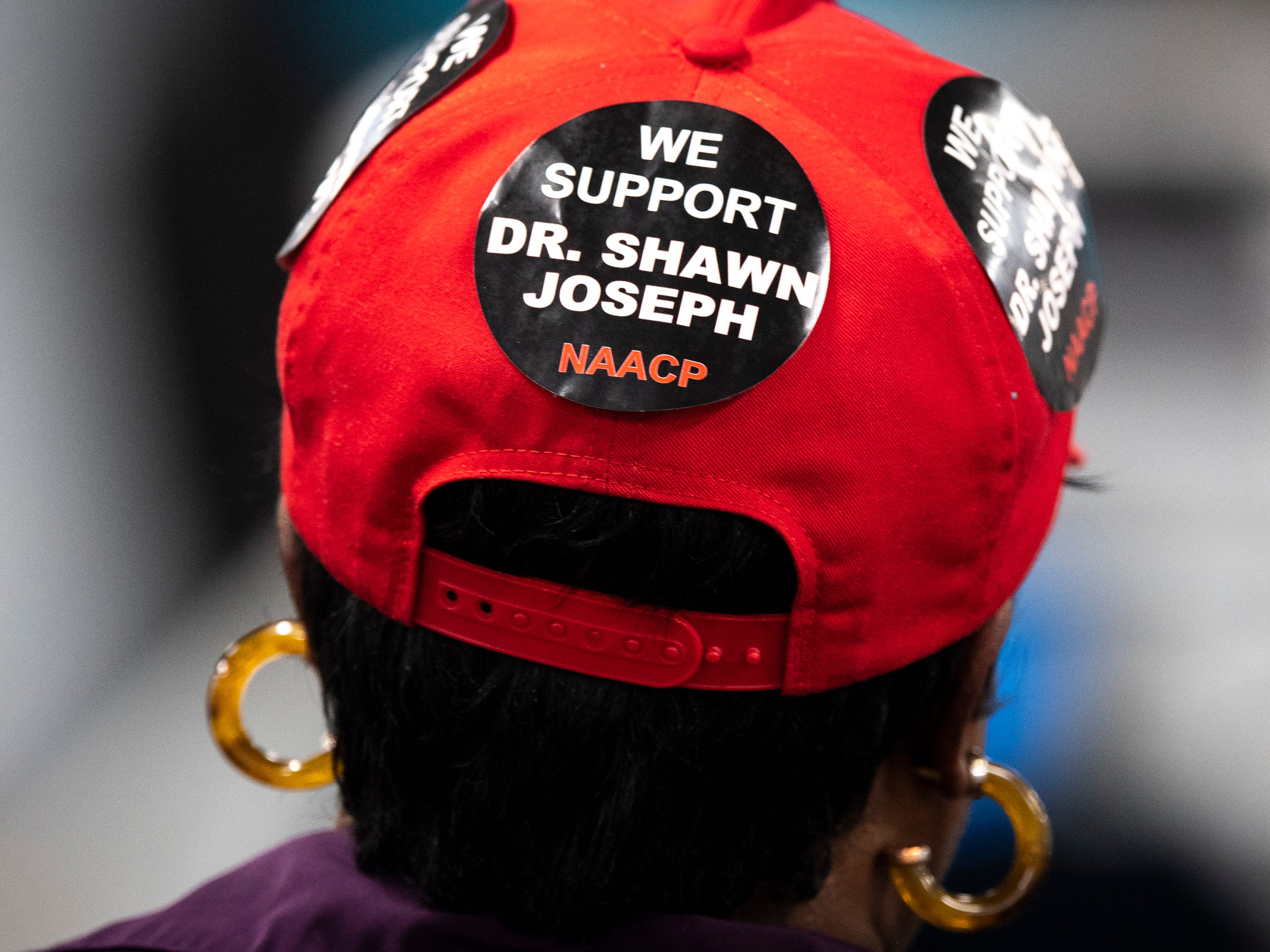 Supporters of Dr. Shawn Joseph listen as the Nashville school board discusses the deal to end the contract of director Shawn Joseph during the MNPS Board of Public Education meeting at the Administration Building of Metropolitan Public Schools in Nashville, Tenn., Tuesday, April 9, 2019.