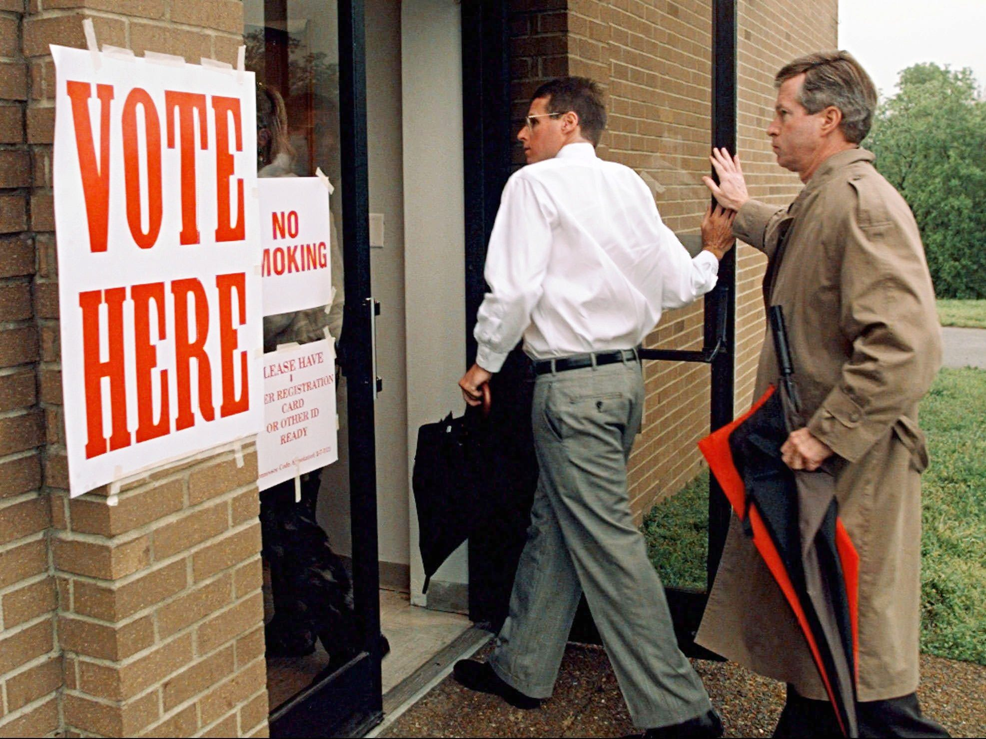 Early morning voters enter the polling place as the doors are opened shortly before 7:00 a.m. at the Holy Trinity Greek Orthodox Church in Nashville May 7, 1996. The decision will be made if public money will be used to help build a new stadium allowing the Houston Oilers to move to Nashville.