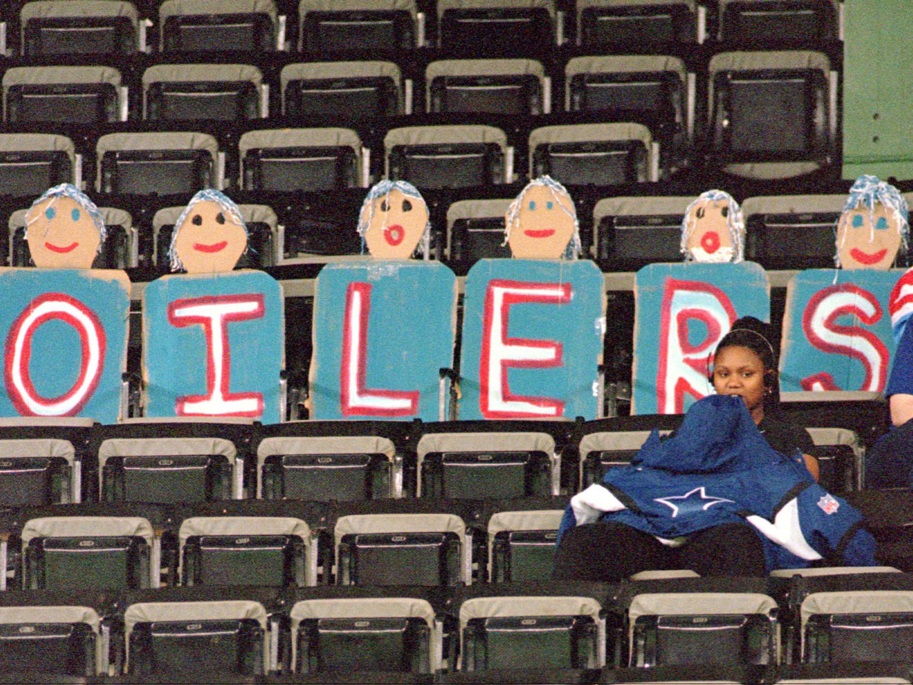 "Houston Oilers ""fans"" fill just six of the 63,001 seats in the Astrodome as the Oilers play the Cincinnati Bengals in their last home game of the season Dec. 15, 1996 in Houston. The lameduck Oilers have found few real fans in their next-to-last season in Houston before the team moves to Nashville."