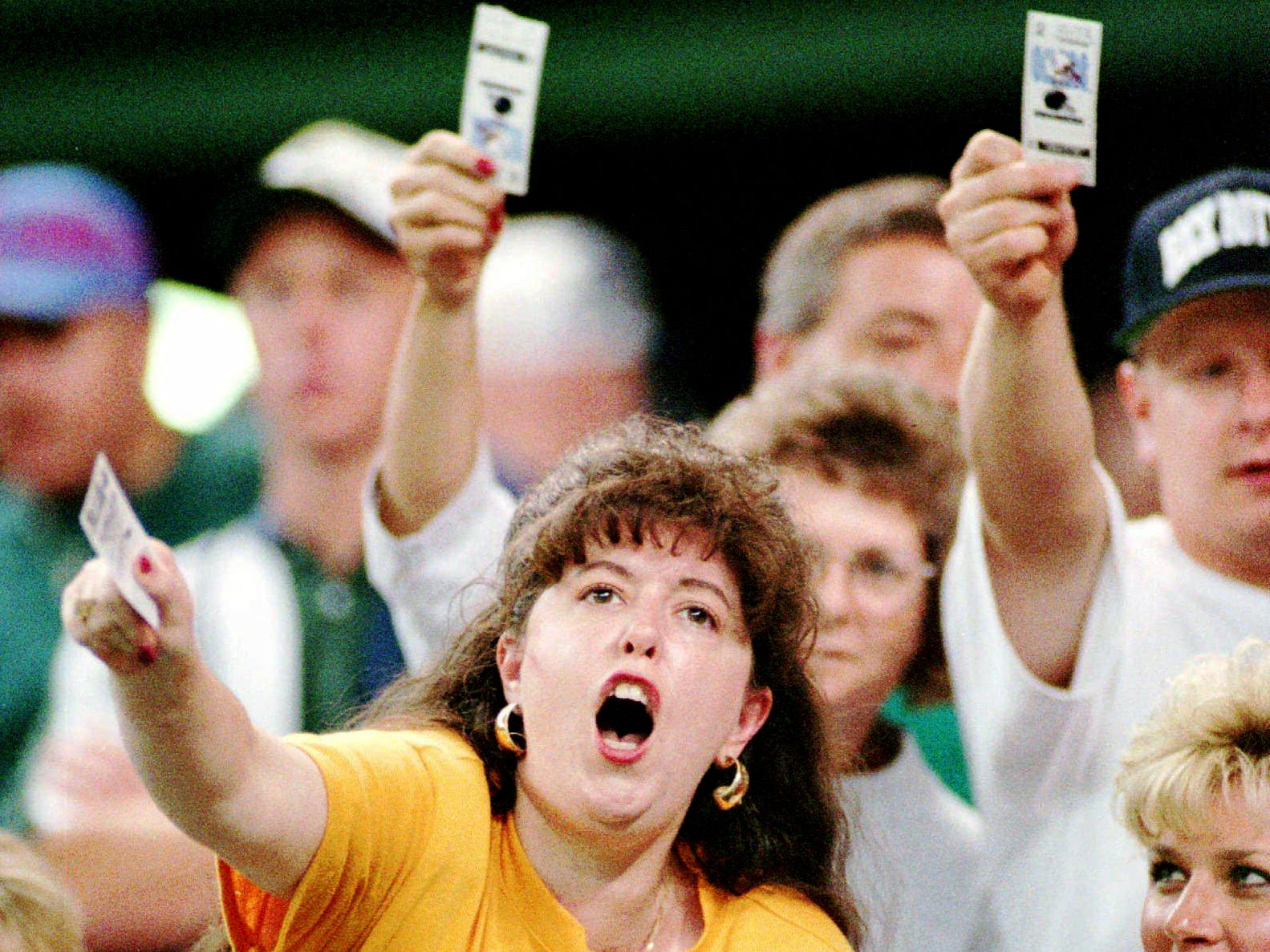Houston Oilers fans scream for a refund as they wave their tickets after the game against the San Diego Chargers was cancelled Aug. 19, 1995 in Houston. The Astrodome field was deemed unplayable by officials who considered the artificial surface unsafe to play on.