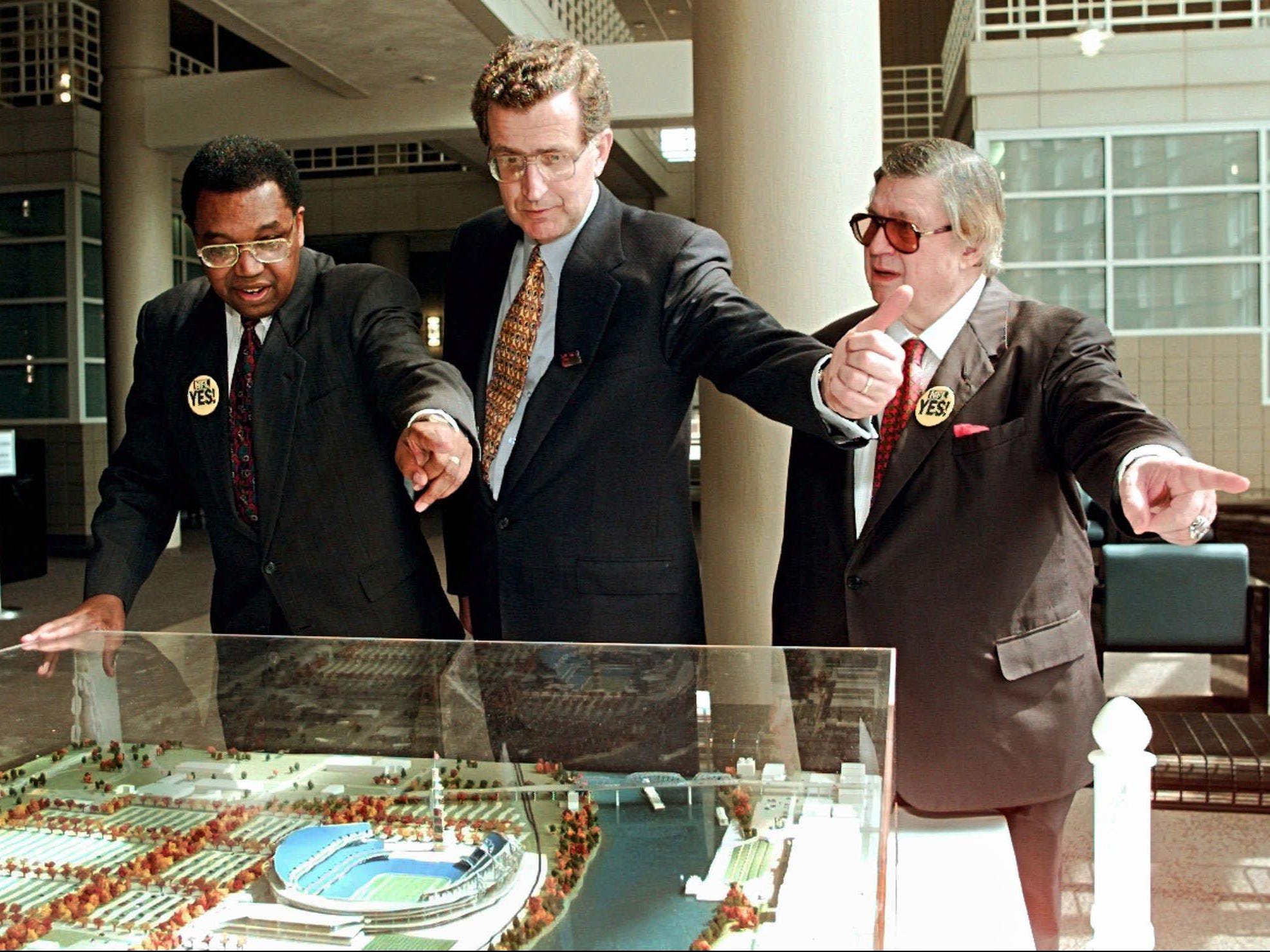 Tennessee State University President James A. Hefner, left, NFL Commissioner Paul Tagliabue and Houston Oilers owner Bud Adams, right, all point in the same direction when an onlooker asked where the Tennessee State campus is from the proposed NFL stadium as they look over a model of the stadium May 6, 1996. Tagliabue and Adams are visiting the Nashville campus as one of several stops on the day before voters decide whether to spend public money on the 65,000-seat stadium.