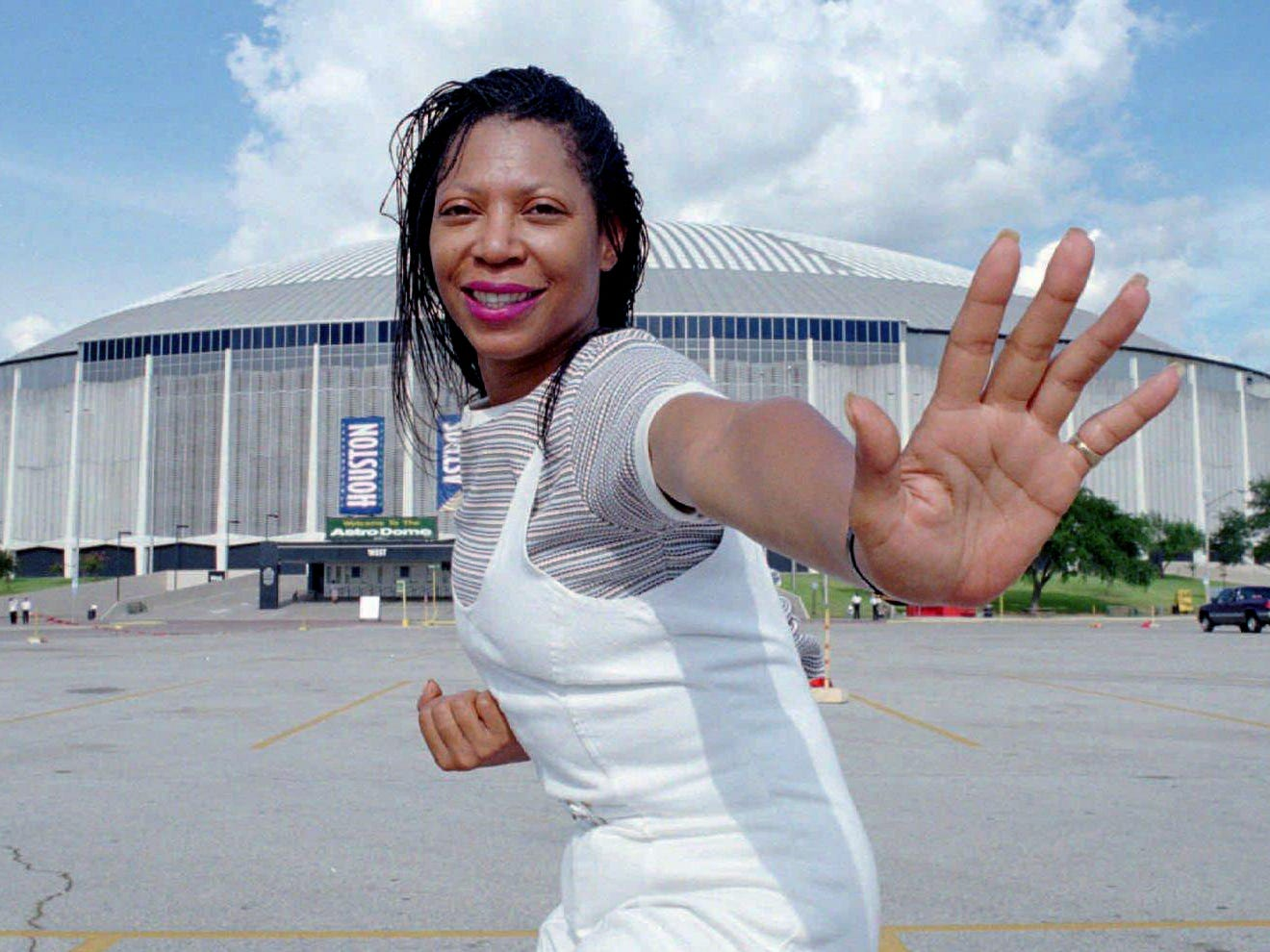 TWA flight attendant Donna George, posing on Aug. 8, 1996 in Houston, was scheduled to work TWA Flight 800 from New York to Paris on July 17 and stay for two days. Instead, George was persuaded to go to San Antonio on July 19 to see her son, Heisman Trophy winner Eddie George, sign a five-year contract with the Houston Oilers.
