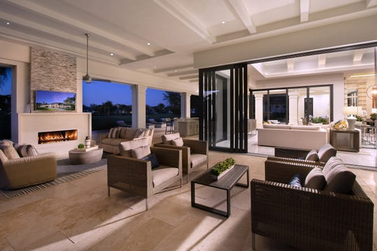 The Sophia III's outdoor living area with fireplace, flows seamlessly back into the family room.