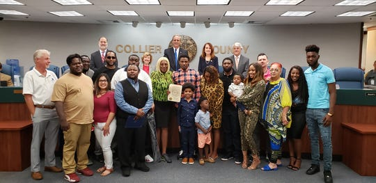 Immokalee native J.C. Jackson (center, plaid shirt) stands with his family in front of the Collier County commissioners at a meeting Tuesday. The commissioners proclaimed it J.C. Jackson Day after the player won the Super Bowl with the New England Patriots as a rookie this past season.