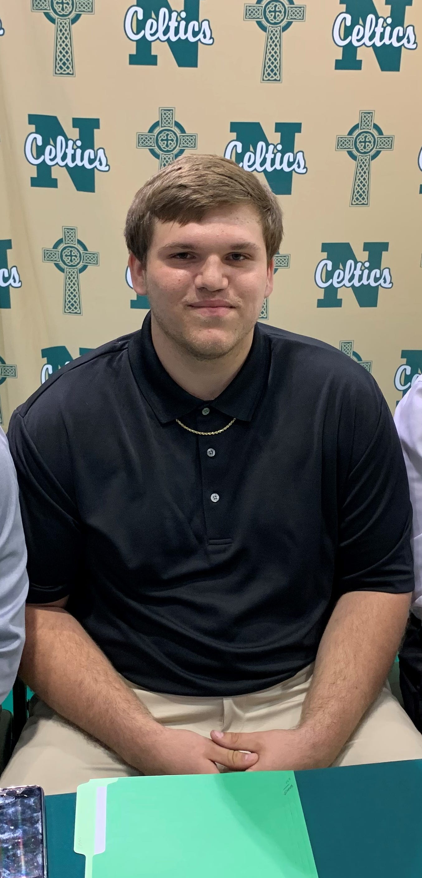 Cameron Foss poses for a picture prior to signing with Greensboro College on Tuesday.