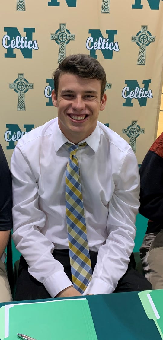 Oliver Wasem poses for a picture prior to signing with Mount St. Joseph on Tuesday.