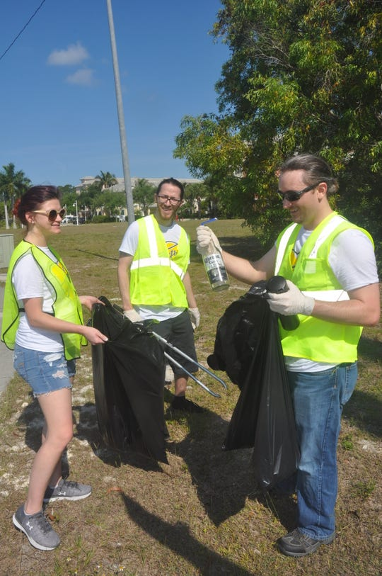 Carrie Gamso, Zachary Birner and Justin Nunn picked up trash along Bonita Beach Road on Friday, April 5, 2019. They were part of a group of 300 volunteers from Hertz that spent the morning helping the environment.