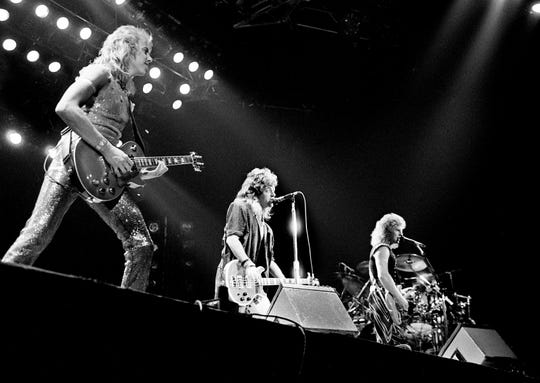 """Jeff Watson, left, Jack Blades and Brad Gillis of Night Ranger is roaring into """"7 Wishes,"""" the title tune of it newest LP as they open the show for some 3,000 fans at Municipal Auditorium Aug. 21, 1985."""