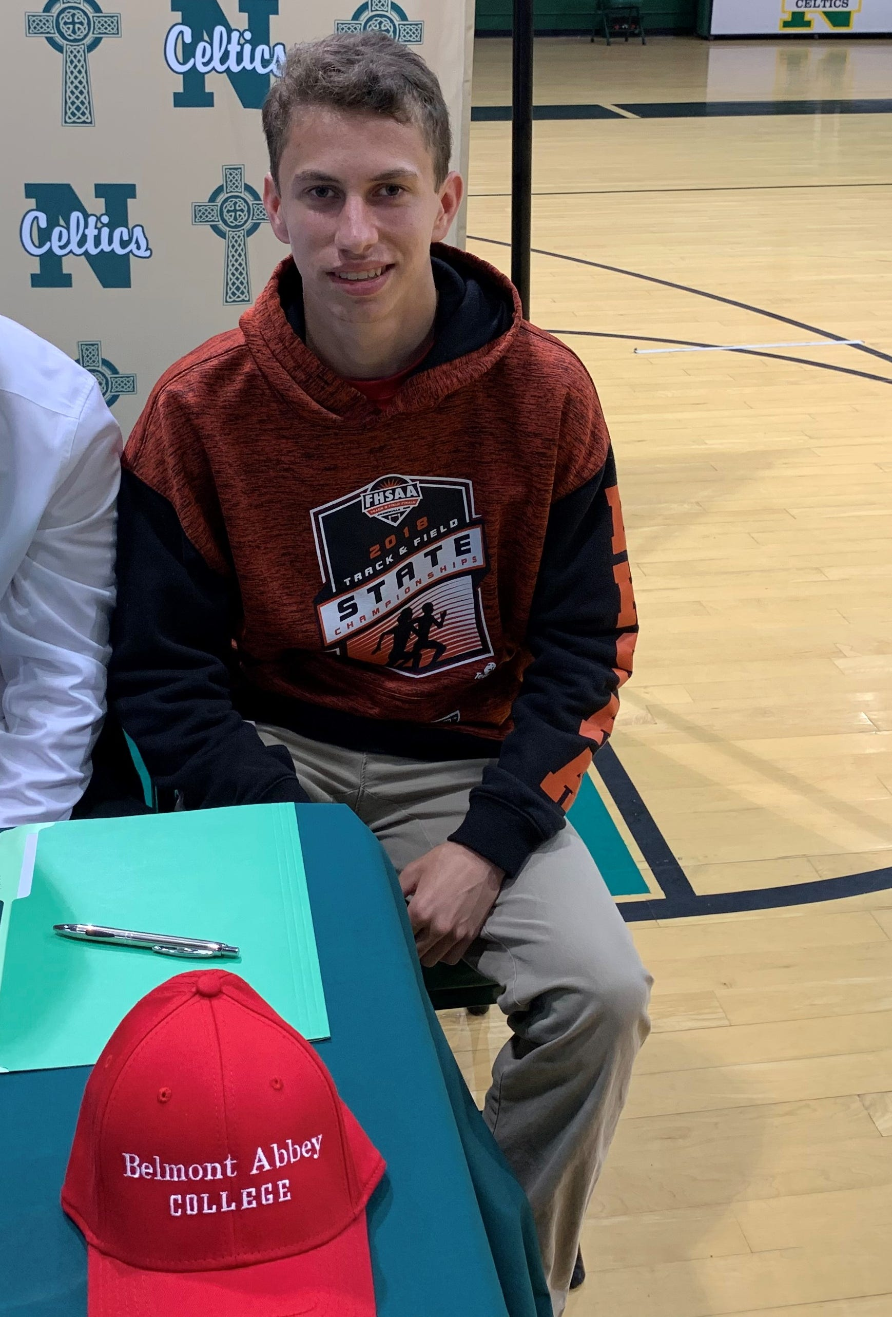 Ryan Kohlhagen poses for a picture prior to signing with Belmont Abbey on Tuesday.