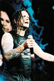 Ozzy Osbourne on stage during a Ozzfest 2001 concert in Indianapolis . (Gannett News Service, Ross Pelton)