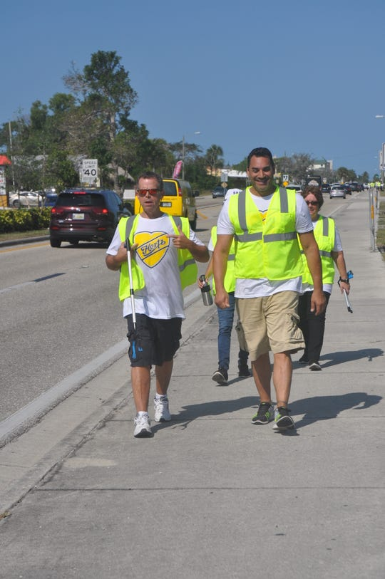 Craig Rose, Jerry Blinsinger, Erika Hudson and Cindy Jones, cleaned up the roadside along Bonita Beach Road on Friday, April 5, 2019. They were part of a group of 300 volunteers from Hertz that spent the morning helping the environment.