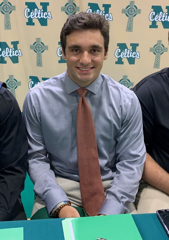 Mauricio Santamarina poses for a picture prior to signing with Washington University in St. Louis on Tuesday.