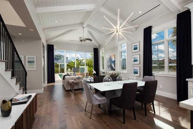 This residence features a two-story old Florida cottage style architecture.