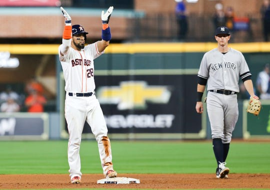 Houston Astros catcher Robinson Chirinos (28) reacts after hitting a RBI double against theNew York Yankees in the seventh inning at Minute Maid Park.