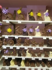 Both vintage and modern chocolate figures line the shelves of Genevieve's Home Made Chocolates in Garfield.
