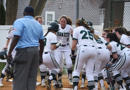 Jada Rodriguez (no.3) of Passaic Valley is congratulated by her teammates at home after hitting two run homer to left field, which makes the game 4 to 1 lead against West Milford in the second inning of their game at Passaic Valley HS in Little Falls on 04/08/19.
