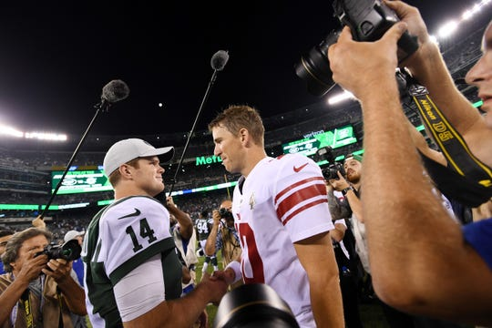 Giants vs. Jets preseason game at MetLife Stadium in East Rutherford on Friday, August 24, 2018. Jets QB Sam Darnold (14) and Giants QB Eli Manning after the game.