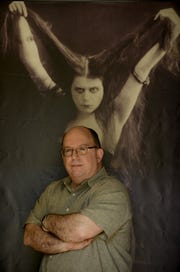Tom Meyers of the Fort Lee Film Commission, posing with silent star Theda Bara