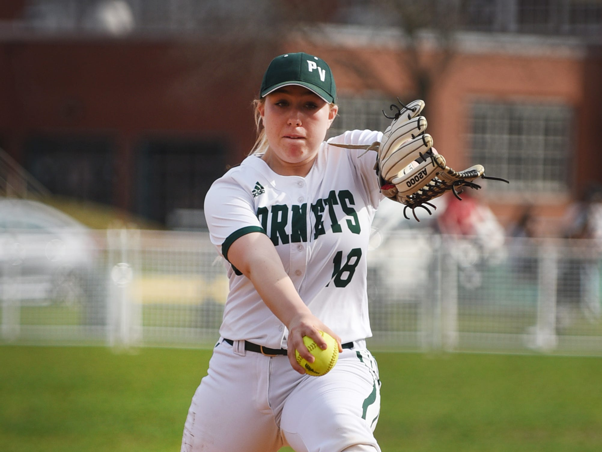 Starting pitcher Shana Donnelly (no.18) of Passaic Valley delivers the pitch against West Milford in the first inning of their game at Passaic Valley HS in Little Falls on 04/08/19.