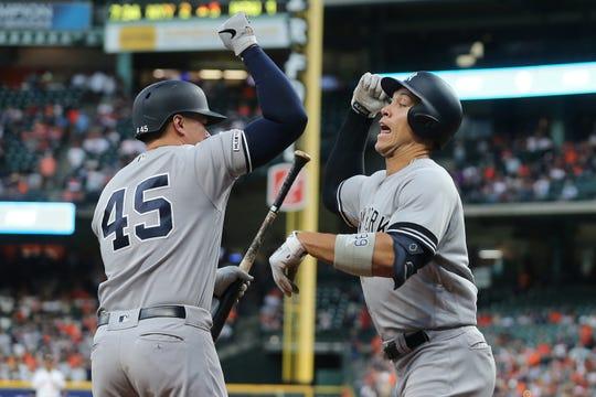 New York Yankees first baseman Luke Voit (45) congratulates right fielder Aaron Judge (99) after he hit a home run against the Houston Astros in the fifth inning at Minute Maid Park.