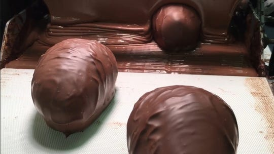A layer of chocolate gets doused over the eggs at Bromilow's Chocolate.