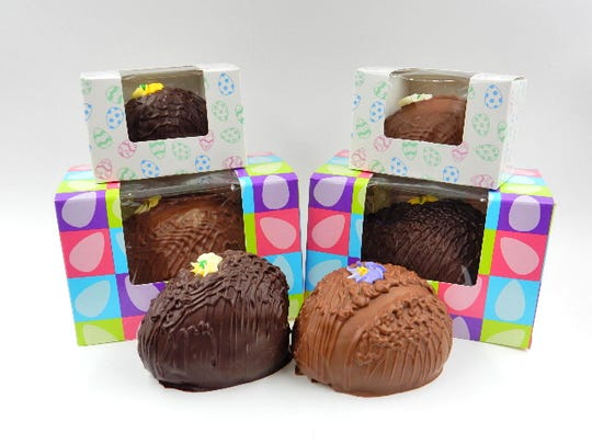 The eggs at Bromilow's Chocolate are decorated with ribs of chocolate at icing flowers.